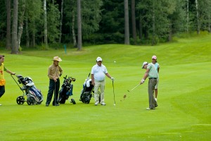 bigstock-Group-unknown-golfer-on-field-15848450